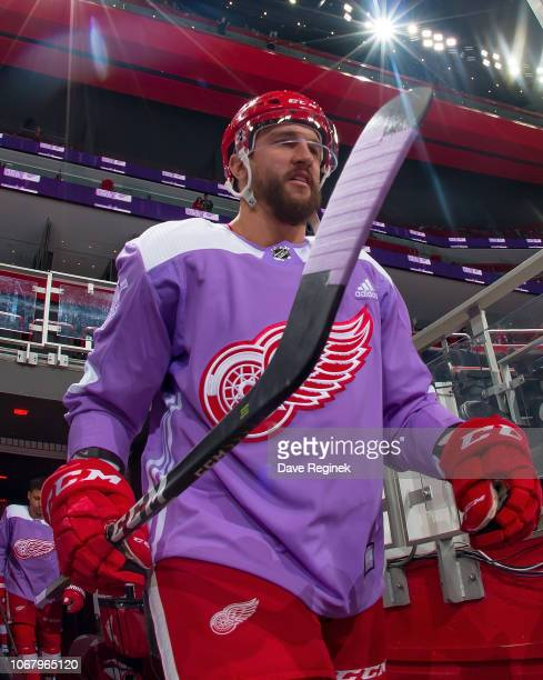 Luke Glendening of the Detroit Red Wings walks out to the rink with his custom Hockey Fights Cancer jersey prior to an NHL game against the Arizona...