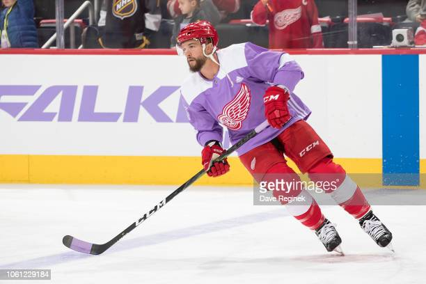 Luke Glendening of the Detroit Red Wings wears a purple jersey for Hockey Fights Cancer night during warm-ups prior to an NHL game against the...