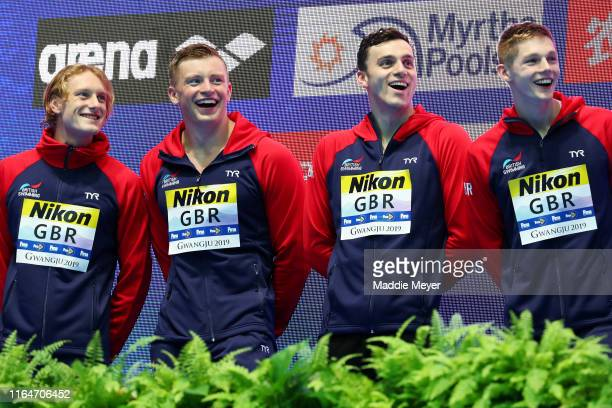 Luke Greenbank Adam Peaty James Guy and Duncan Scott of Great Britain celebrate on the podium at the medal ceremony for the Men's 4x100m Medley Relay...
