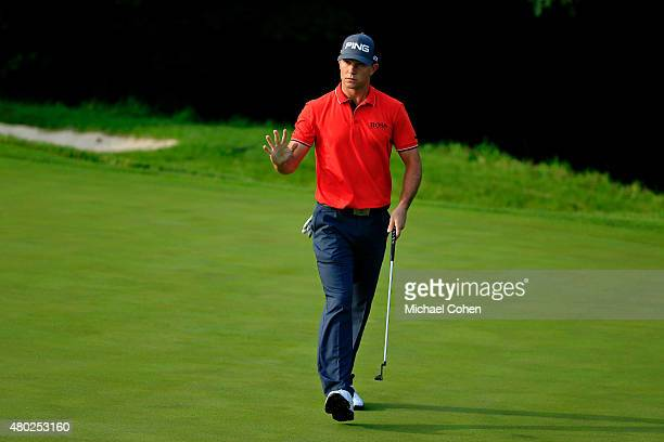 Luke Guthrie acknowledges the gallery after making par on the 11th hole during the second round of the John Deere Classic held at TPC Deere Run on...