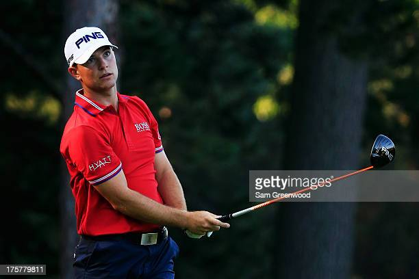 Luke Guthrie of the United States hits his tee shot on the fourth hole during the first round of the 95th PGA Championship on August 8 2013 in...