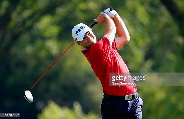 Luke Guthrie of the United States hits his tee shot on the ninth hole during the first round of the 95th PGA Championship on August 8, 2013 in...