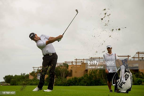 Luke Guthrie of the United States plays an approach shot at the 17th hole during the first round of the 2013 OHL Classic at Mayakoba, played at El...