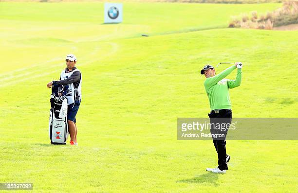 Luke Guthrie of the USA hits his second shot on the ninth hole during the third round of the BMW Masters at Lake Malaren Golf Club on October 26,...