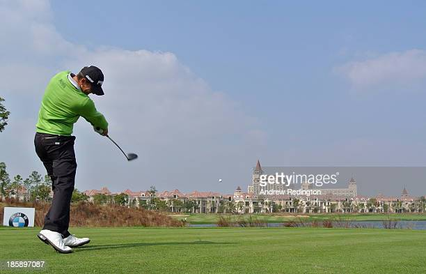 Luke Guthrie of the USA hits his tee-shot on the ninth hole during the third round of the BMW Masters at Lake Malaren Golf Club on October 26, 2013...