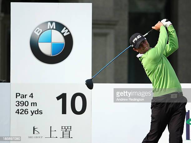 Luke Guthrie of the USA hits his tee-shot on the tenth hole during the third round of the BMW Masters at Lake Malaren Golf Club on October 26, 2013...