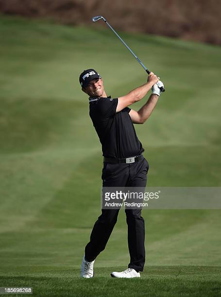 Luke Guthrie of the USA plays his second shot on the 18th hole during the first round of the BMW Masters at Lake Malaren Golf Club on October 24,...