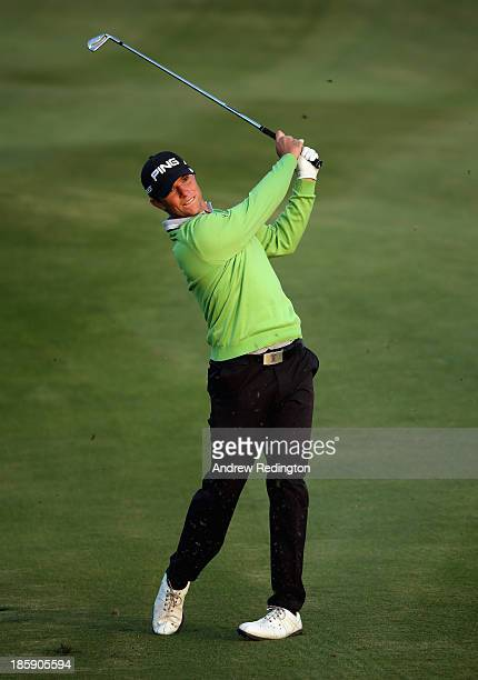 Luke Guthrie of the USA plays his second shot on the 18th hole during the third round of the BMW Masters at Lake Malaren Golf Club on October 26,...