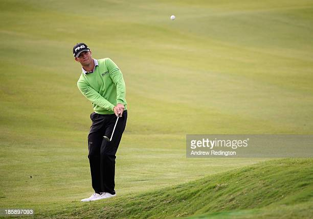 Luke Guthrie of the USA plays his third shot on the ninth hole during the third round of the BMW Masters at Lake Malaren Golf Club on October 26,...