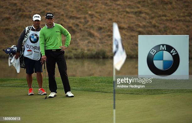 Luke Guthrie of the USA stands with brother and caddie Zach Guthrie on the 18th hole during the third round of the BMW Masters at Lake Malaren Golf...