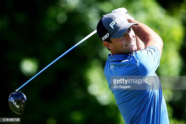 Luke Guthrie plays his shot from the 13th tee during the first round of the Travelers Championship at TPC River Highlands on June 25 2015 in Cromwell...