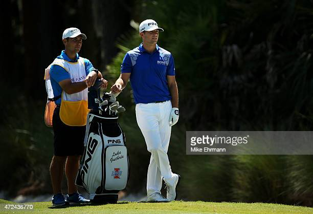 Luke Guthrie prepares to play a shot with his brother and caddie Zach Guthrie during round one of THE PLAYERS Championship at the TPC Sawgrass...