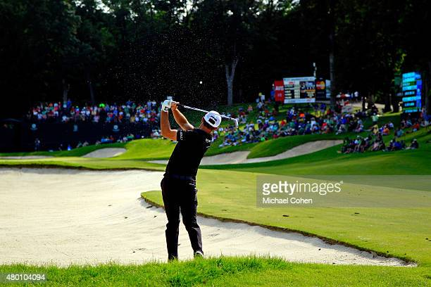 Luke Guthrie takes his second shot on the18th hole during the first round of the John Deere Classic held at TPC Deere Run on July 9 2015 in Silvis...