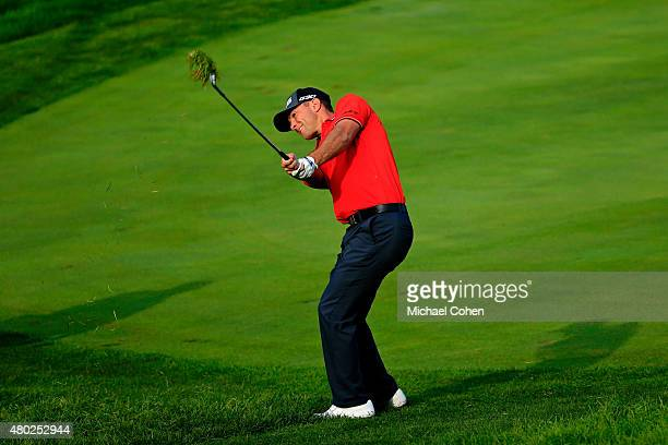 Luke Guthrie takes his third shot on the 11th hole during the second round of the John Deere Classic held at TPC Deere Run on July 10, 2015 in...