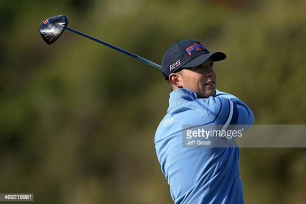 Luke Guthrie watches his shot in the first round of the Northern Trust Open at the Riviera Country Club on February 13, 2014 in Pacific Palisades,...