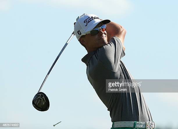Luke Guthrie watches his tee shot on the 14th hole during the second round of the Quicken Loans National at the Robert Trent Jones Golf Club on July...