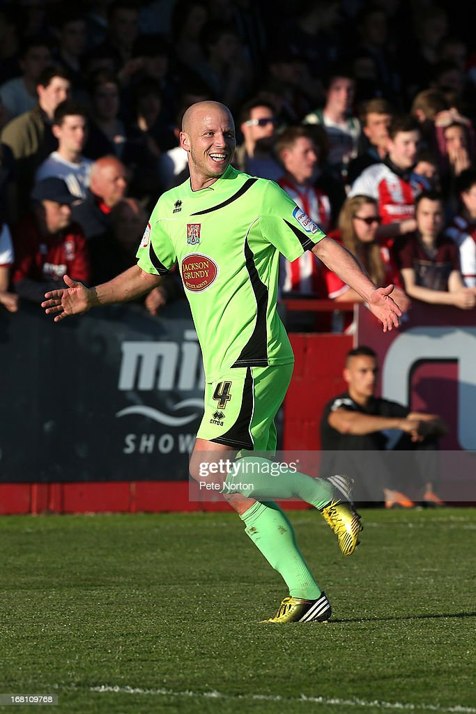 Luke Guttridge of Northampton Town celebrates after scoring his team's first goal during the npower League Two Play Off Semi Final Second Leg between Cheltenham Town and Northampton Town at Abbey Business Stadium on May 5, 2013 in Cheltenham, England.