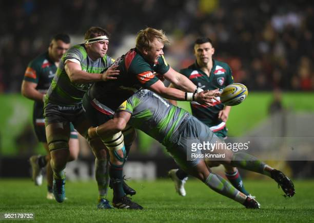 Luke Hamilton of Leicester Tigers is tackled by Sam Lockwood of Newcastle Falcons during the Aviva Premiership match between Leicester Tigers and...