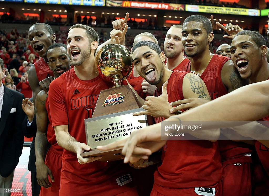 Luke Hancock #11 and Peyton Siva #3 of the Louisville Cardinals celebrate and hold the Big East Conference Regular Sean Championship trophy after beating the Notre Dame Fighting Irish at KFC YUM! Center on March 9, 2013 in Louisville, Kentucky.