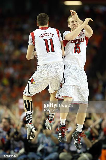 Luke Hancock and Tim Henderson of the Louisville Cardinals celebrate in the second half against the Wichita State Shockers during the 2013 NCAA Men's...
