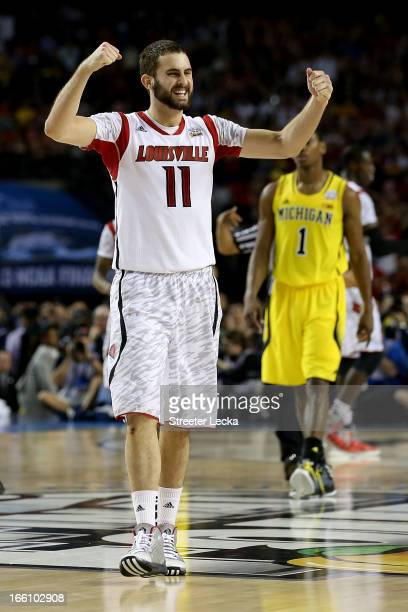 Luke Hancock of the Louisville Cardinals celebrates their 82-76 win against the Michigan Wolverines during the 2013 NCAA Men's Final Four...