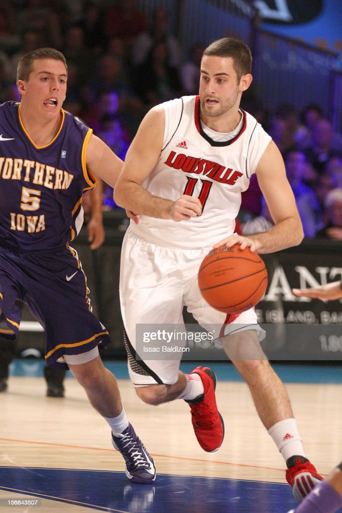 Luke Hancock #11 of the Louisville Cardinals drives against Matt Bohannan #5 of the Northern Iowa Panthers during the Battle 4 Atlantis tournament at Atlantis Resort on November 22, 2012 in Nassau, Paradise Island, Bahamas.