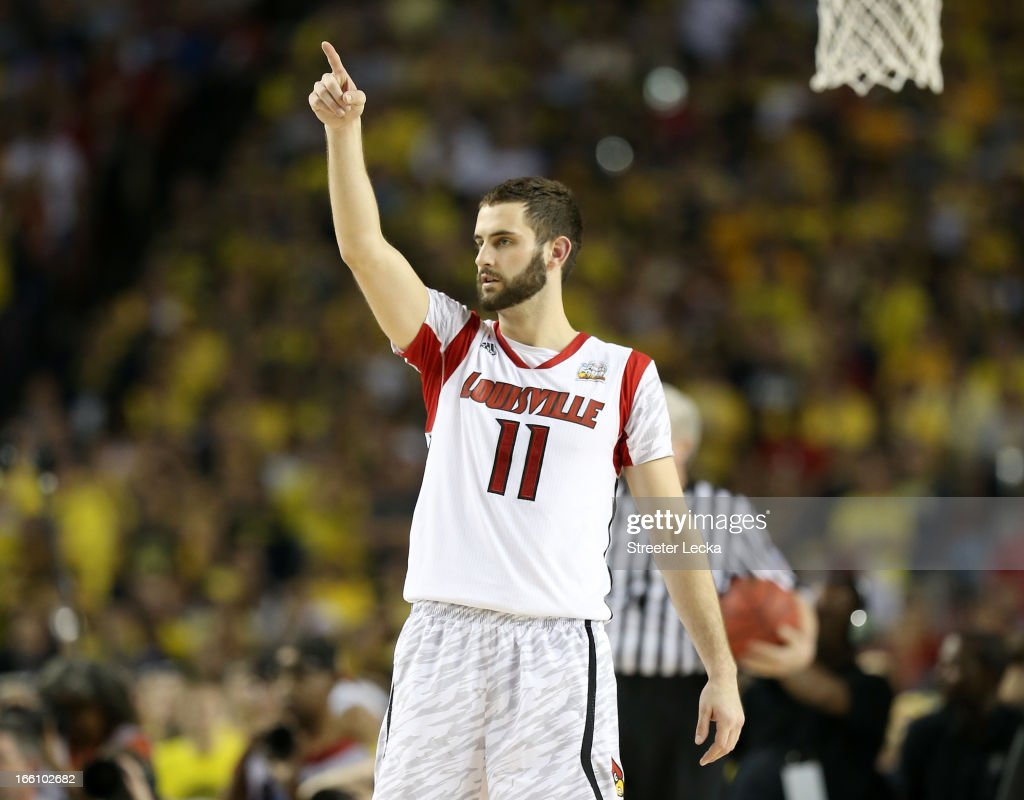 Luke Hancock #11 of the Louisville Cardinals reacts in the secon dhalf against the Michigan Wolverines during the 2013 NCAA Men's Final Four Championship at the Georgia Dome on April 8, 2013 in Atlanta, Georgia.