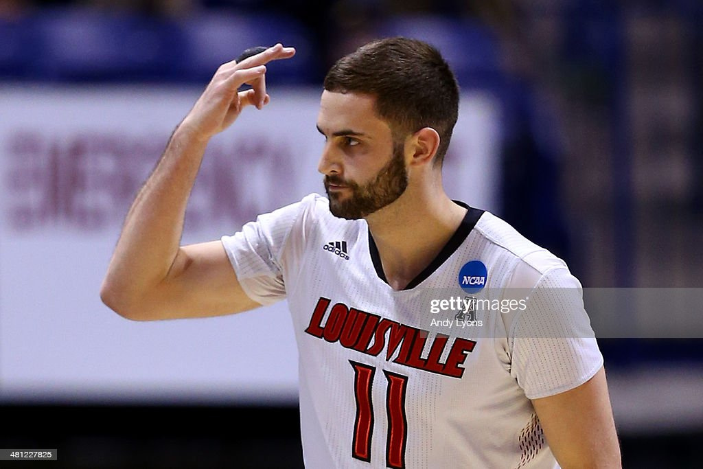 Luke Hancock #11 of the Louisville Cardinals reacts to a play against the Kentucky Wildcats during the regional semifinal of the 2014 NCAA Men's Basketball Tournament at Lucas Oil Stadium on March 28, 2014 in Indianapolis, Indiana.