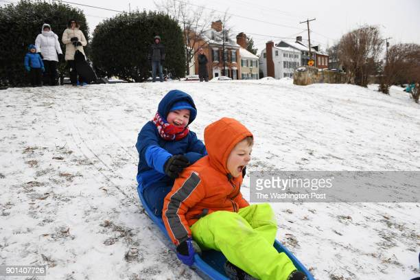 Luke Harrington center and Alex Fitzgerald Courtenay bottom right center sled at Windmill Hill Park after a storm hit the area on Thursday January 04...