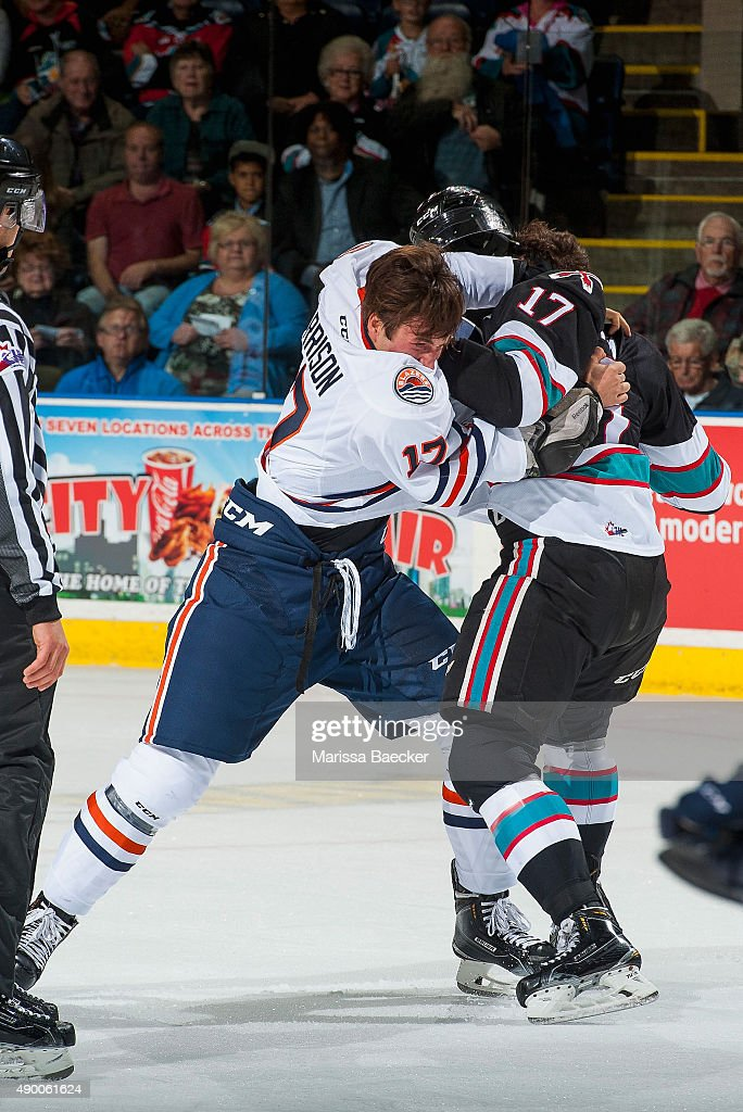Luke Harrison #17 of Kamloops Blazers drops the gloves with Rodney Southam #17 of Kelowna Rockets during the first period on September 25, 2015 at Prospera Place in Kelowna, British Columbia, Canada.