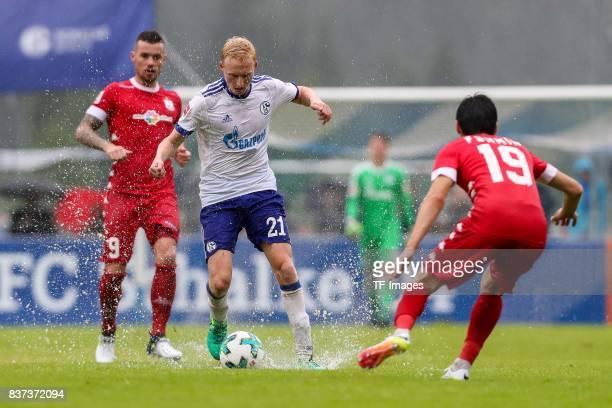 Luke Hemmerich of Schalke battle for the ball during the preseason friendly match between FC Schalke 04 and Neftchi Baku on July 26 2017 in...