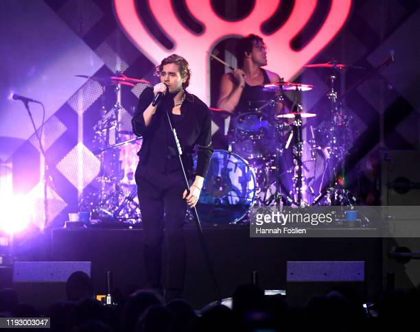Luke Hemmings and Ashton Irwin of 5 Seconds of Summer perform onstage during 101.3 KDWB's Jingle Ball 2019 Presented by Capital One at Xcel Energy...