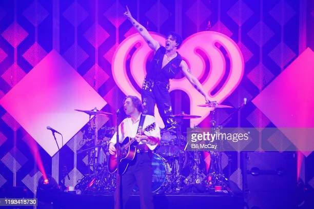 Luke Hemmings and Ashton Irwin of '5 Seconds of Summer' perform onstage during Q102's Jingle Ball 2019 Presented by Capital One at Wells Fargo Center...