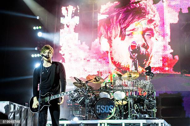 Luke Hemmings and Ashton Irwin of 5 Seconds of Summer perform onstage at The O2 Arena on April 8 2016 in London England