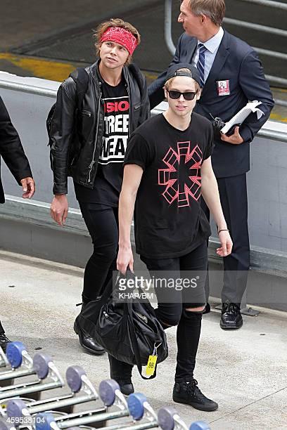 Luke Hemmings and Ashton Irwin of Five Seconds of Summer arrive in Sydney on November 25 2014 in Sydney Australia