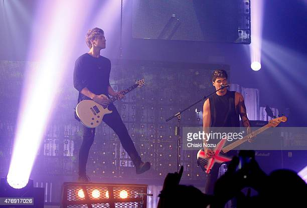 Luke Hemmings and Calum Hood of 5 Seconds of Summer perform at Wembley Arena on June 12 2015 in London England