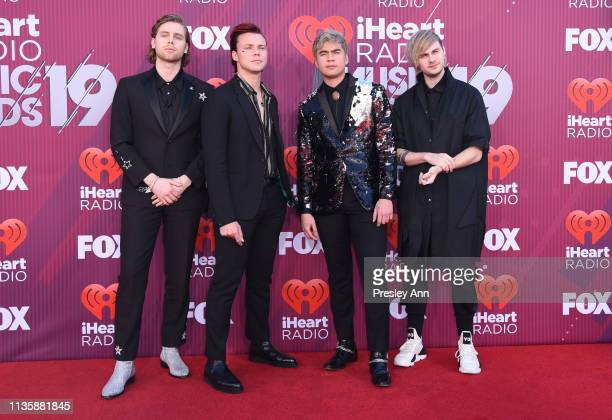 Luke Hemmings Ashton Irwin Calum Hood and Michael Clifford of 5 Seconds of Summer attend the 2019 iHeartRadio Music Awards which broadcasted live on...