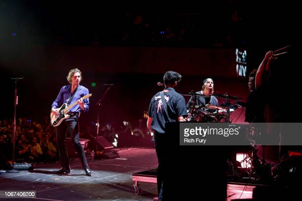 Luke Hemmings Calum Hood Michael Clifford and Ashton Irwin of 5 Seconds of Summer perform onstage during WiLD 949's FM's Jingle Ball 2018 Presented...
