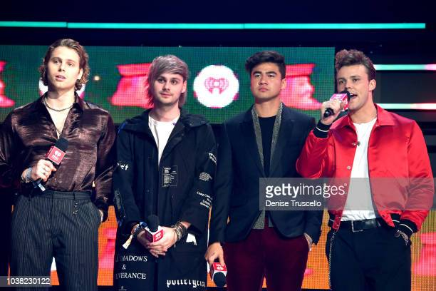 Luke Hemmings Michael Clifford Calum Hood and Ashton Irwin of 5 Seconds of Summer speak onstage during the 2018 iHeartRadio Music Festival at TMobile...