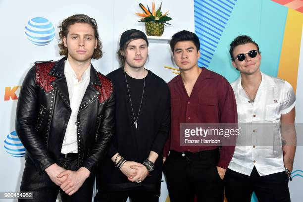 Luke Hemmings Michael Clifford Calum Hood and Ashton Irwin of music group 5 Seconds of Summer attend iHeartRadio's KIIS FM Wango Tango by ATT at Banc...