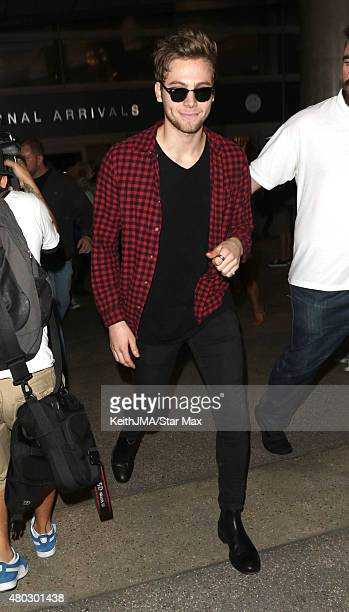 Luke Hemmings of 5 Seconds of Summer are seen on July 10 2015 in Los Angeles California