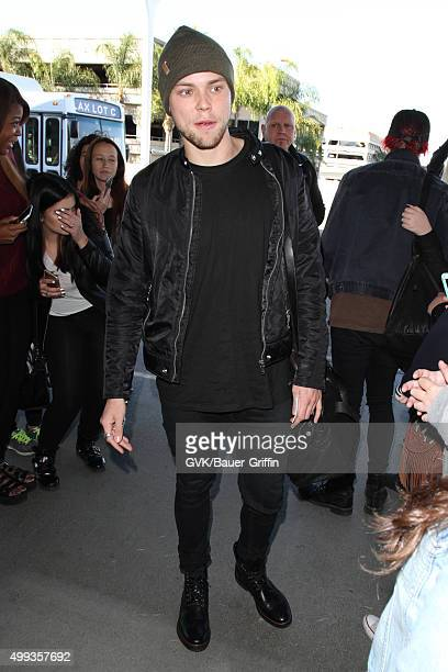 Luke Hemmings of Five Seconds of Summer is seen at LAX on November 30 2015 in Los Angeles California