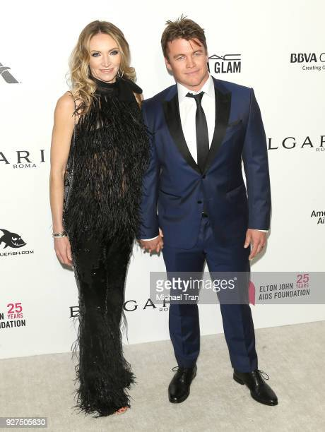 Luke Hemsworth and Samantha Hemsworth arrive to the 26th Annual Elton John AIDS Foundation's Academy Awards Viewing Party held at West Hollywood Park...