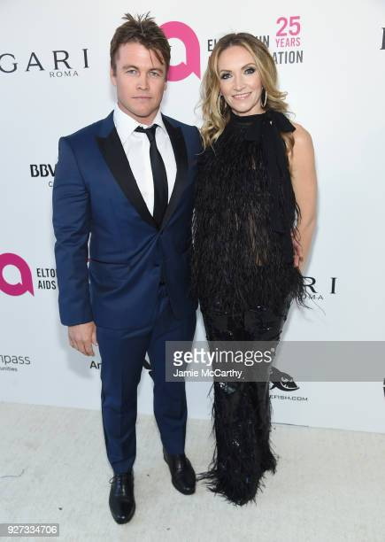 Luke Hemsworth and Samantha Hemsworth attend the 26th annual Elton John AIDS Foundation Academy Awards Viewing Party sponsored by Bulgari,...