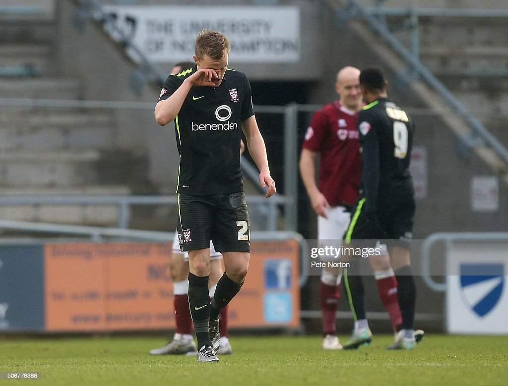 Luke Hendrie of York City walks dejectedly from the pitch after being shown a red card during the Sky Bet League Two match between Northampton Town and York City at Sixfields Stadium on February 6, 2016 in Northampton, England.