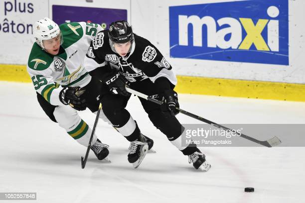 Luke Henman of the BlainvilleBoisbriand Armada skates the puck against Felix Boivin of the ValdOr Foreurs during the QMJHL game at Centre...