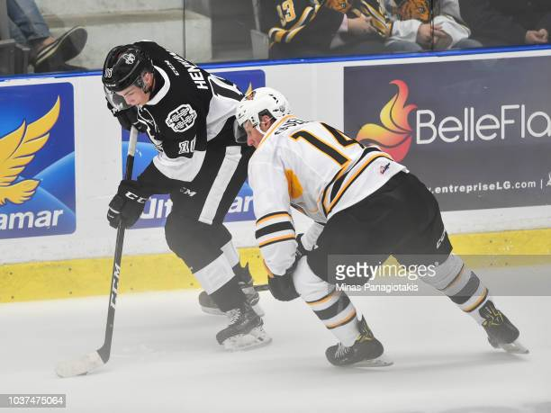 Luke Henman of the BlainvilleBoisbriand Armada skates the puck against Edouard Ouellet of the Victoriaville Tigres during the QMJHL game at Centre...