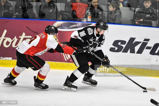 Luke Henman of the BlainvilleBoisbriand Armada skates the puck against Gabriel Fortier of the BaieComeau Drakkar during the QMJHL game at Centre...