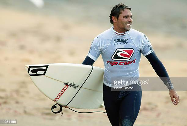 Luke Hitchings of Australia walks up the beach after his first round win during the Rip Curl Pro on April 16 2003 at Bells Beach in Torquay Australia...