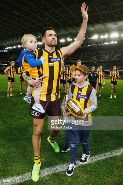 Luke Hodge of the Hawks celebrates the win with his kids after his retirement match during round 23 AFL match between the Hawthorn Hawks and the...